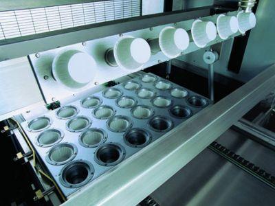 Màquina dosificadora de càpsules.