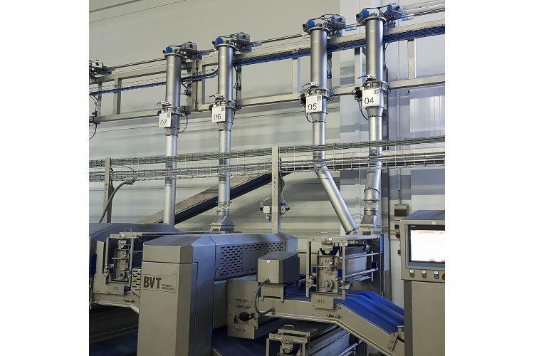 Sistema d'ompliment automàtic de farinadors
